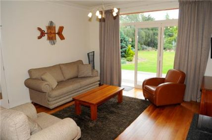 The comfortable lounge room overlooks the large private garden.