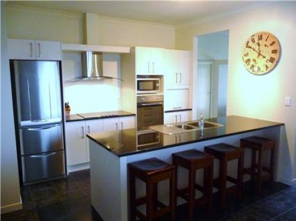 The fully equipped granite kitchen allow for easy preparation of holiday meals.