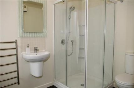 Both bathrooms are modern and have heated towel rails.